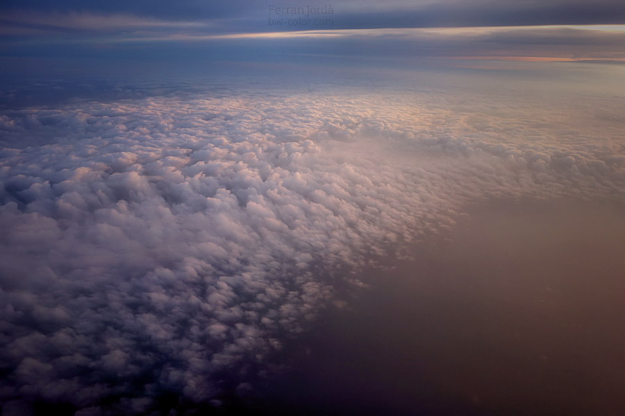 a sunset over the clouds